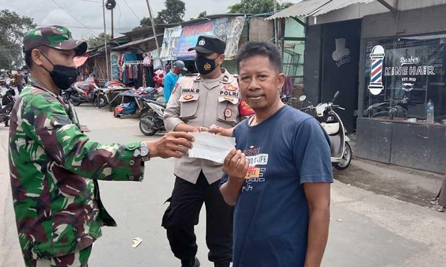 Tegakkan Prokes, Puluhan Ribu Masker Dibagikan di Wilayah Hukum Polresta Tangerang